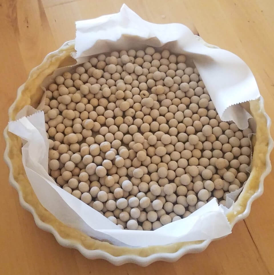 Ceramic beans in pastry case for blind baking.
