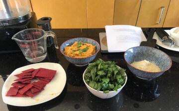 Beetroot crackers, carrot hummus, carrot top pesto