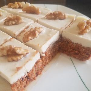 Raw carrot cake with vanilla cashew cream topping.