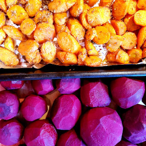 Roasted beets and carrots roasted with cumin seeds and maple syrup.