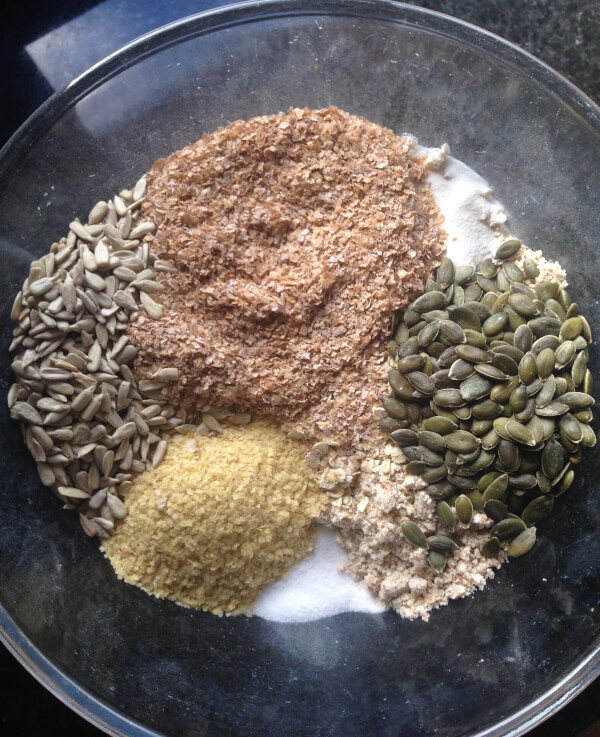 All the dry ingredients in a bowl: flour, wheat bran, wheat germ, salt, bicarbonate of soda and seeds.