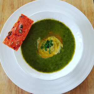 Wild garlic soup with beetroot and pumpkin seed cracker.